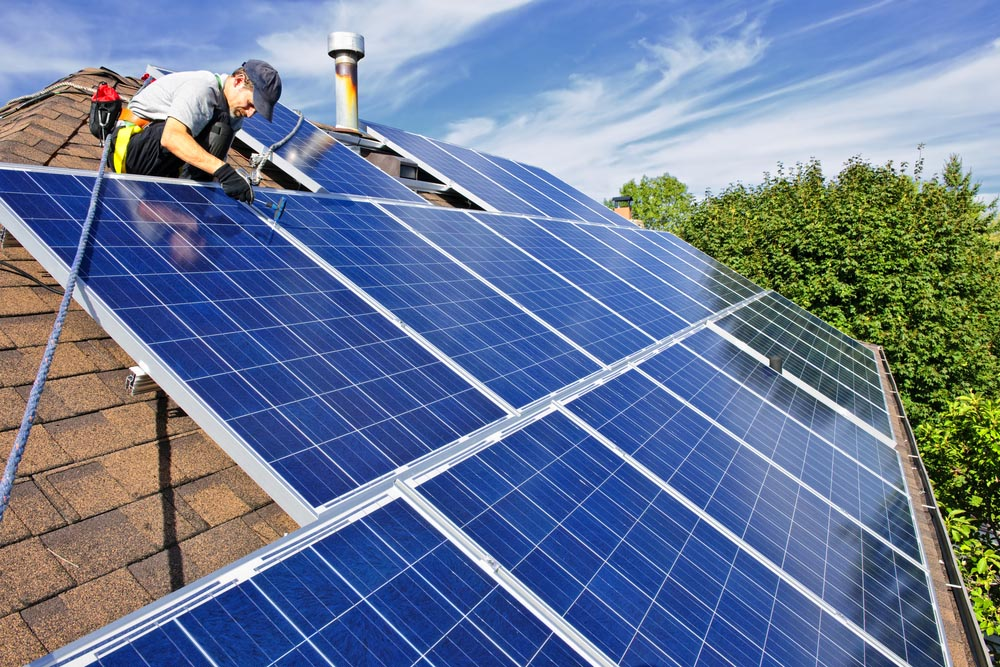 A Man Working On Installing Solar Panels On A House Residential Solar Roofing Nashville Music City Solar Solutions 2306 Eugenia Ave Suite A Nashville Tn 37211 (615) 692 1602
