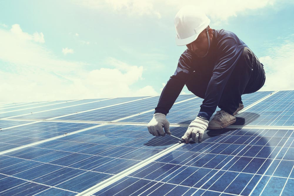 Man Working On Solar Panels On Roof Of A House Residential Solar Roofing Nashville Music City Solar Solutions 2306 Eugenia Ave Suite A Nashville Tn 37211 (615) 692 1602