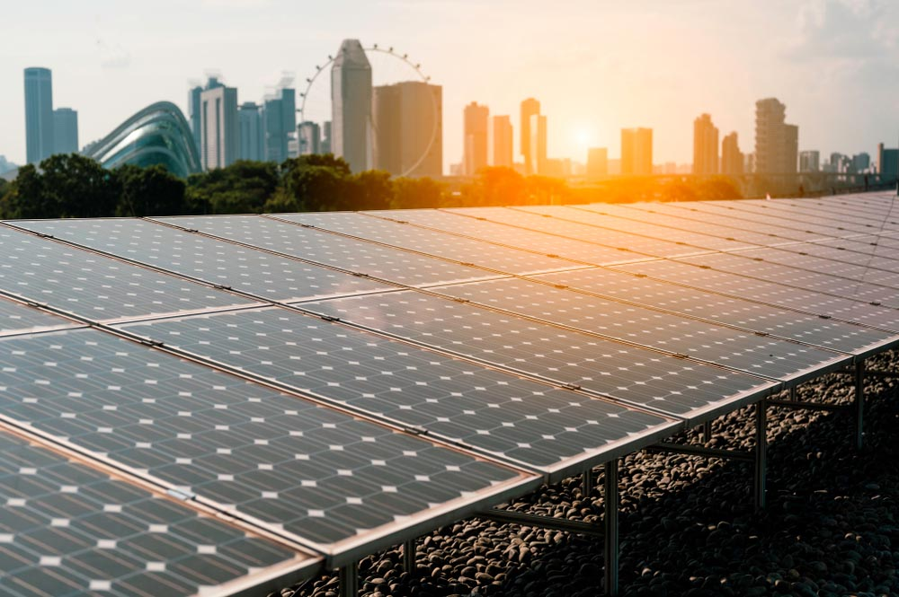 Solar Energy Panels With View Of City At Sunset Commercial Solar Roofing Nashville Music City Solar Solutions 2306 Eugenia Ave Suite A Nashville Tn 37211 (615) 692 1602